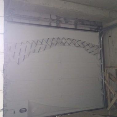 Секционные ворота. Паркинг в строящейся гостинице в Никите 09
