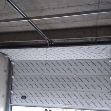 Секционные ворота. Паркинг в строящейся гостинице в Никите 04